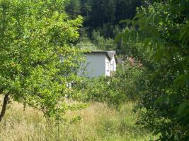Foto 3 1-2 Familienhaus mit grossem Garten