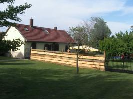 Foto 2 2 Häuser mit Pool , Liegefläche und großem Rieddachhaus !!!