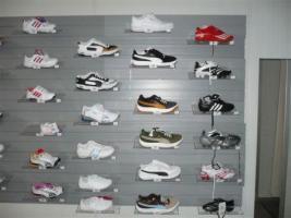 Aus der Verwertung einer Insolvenz (Sporttextilien)Puma, Nike, Adidas, Reebok