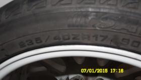 Foto 8 Auto Reifen mit Felge