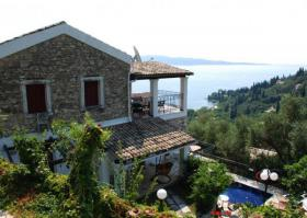 Beautiful renovated stone house with veranda and pool/Greece