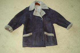 Foto 2 Braune Lederjacke mit gewachsenem Fell
