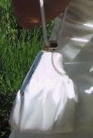 Foto 5 Brautkleid in einem zarten Elfenbein