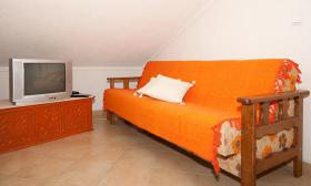 Wohnbereich mit Schlafsofa für dritte Person