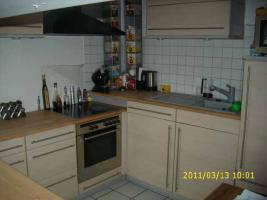 Foto 2 Einbauküche in Ahorn