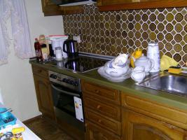 Foto 2 Einbauküche / Küchenzeile aus Echtholz Eiche mit Siemens-Dunstabzugshaube und Einbaukühlschrank