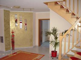 Foto 3 Einfamilienhaus mit Doppelgarage