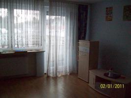 Foto 2 Großzügige Reihenhaus-Wohnung auf zwei Etagen