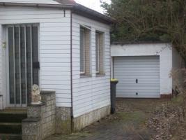 Foto 2 Haus mit Grundstück etwa 900m² mit Garage & Werkstadt Sanierungsbedürftig in 04552 Borna, Siedlung Kesselshain 01.