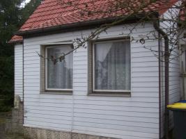 Foto 7 Haus mit Grundstück etwa 900m² mit Garage & Werkstadt Sanierungsbedürftig in 04552 Borna, Siedlung Kesselshain 01.