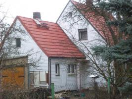 Foto 11 Haus mit Grundstück etwa 900m² mit Garage & Werkstadt Sanierungsbedürftig in 04552 Borna, Siedlung Kesselshain 01.