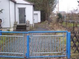 Foto 15 Haus mit Grundstück etwa 900m² mit Garage & Werkstadt Sanierungsbedürftig in 04552 Borna, Siedlung Kesselshain 01.