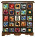 Holzkommode mit 25 farbenfroh handbemalten Keramikschubladen