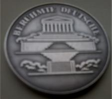 Medaille und Münze