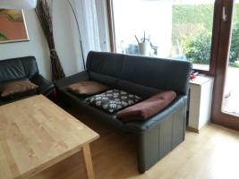 Foto 2 Moderne-Schwarze-Leder-Couchgarnitur