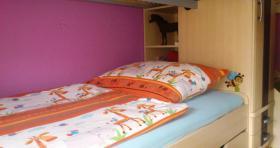 Foto 3 Neuwertiges Kinderhochbettsystem in Ahorn