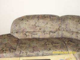 Rundecke mit dazu gehörenden Sessel
