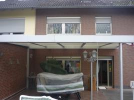 Foto 2 Terrassenüberdachung / offener Wintergarten