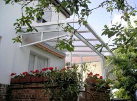Foto 4 Terrassenüberdachungen mit Spiegelglas 6 x 3 m
