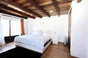 Schlafzimmer mit großem Doppelbett- Casa Mi Carino
