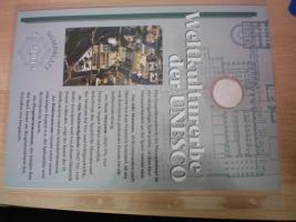 Foto 8 numisblätter mit münzen