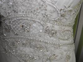 Foto 2 ungetragenes Brautkleid / Hochzeitskleid in der Größe 38