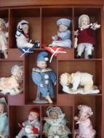 11 Puppen-Babys incl. Schaukasten