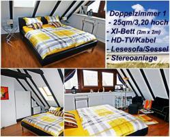 Doppelzimmer 1 mit XL-Bett und Leseecke