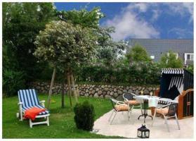 Terrasse und Garten der Ferienwohnung Sylter Deichwiesen