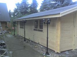 Foto 2 Blockbohlengaragen, Holzgaragen, Garagen, Blockhäuser, in vielen Grössen und Varianten von Standard bis individuell gefertigt, ..