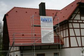 Dachbeschichtung von Fautz im Farbton ziegelrot.