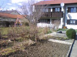 Eigentumswohnung in 2-Familienhaus, Garten, Garagen