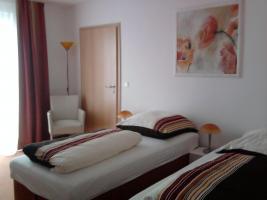 swuite für 4 Personen/2 getrennte Zimmer mit je 2 Betten .