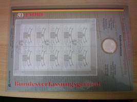 Foto 4 numisblätter mit münzen